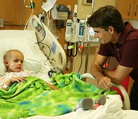 Jeff Gordon visits with patient at Riley Hospital
