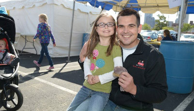 Riley neonatologist Shawn Ahlfeld, M.D., with former NICU patient Molly Hess